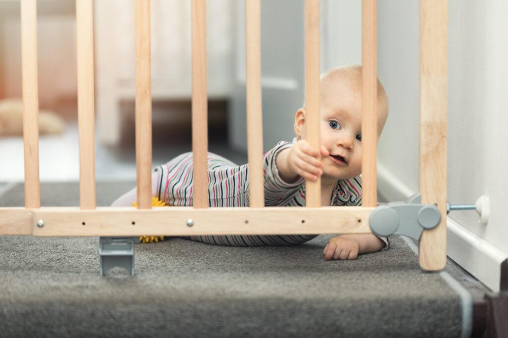 child behind baby gate