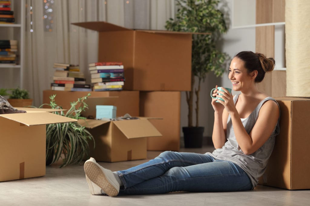 woman moving into apartment