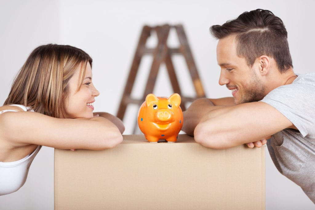 couple over piggy bank