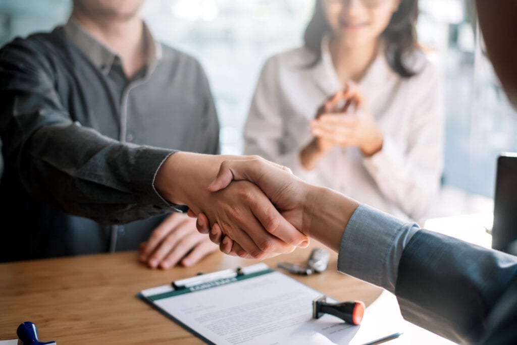 man shaking hand after business deal