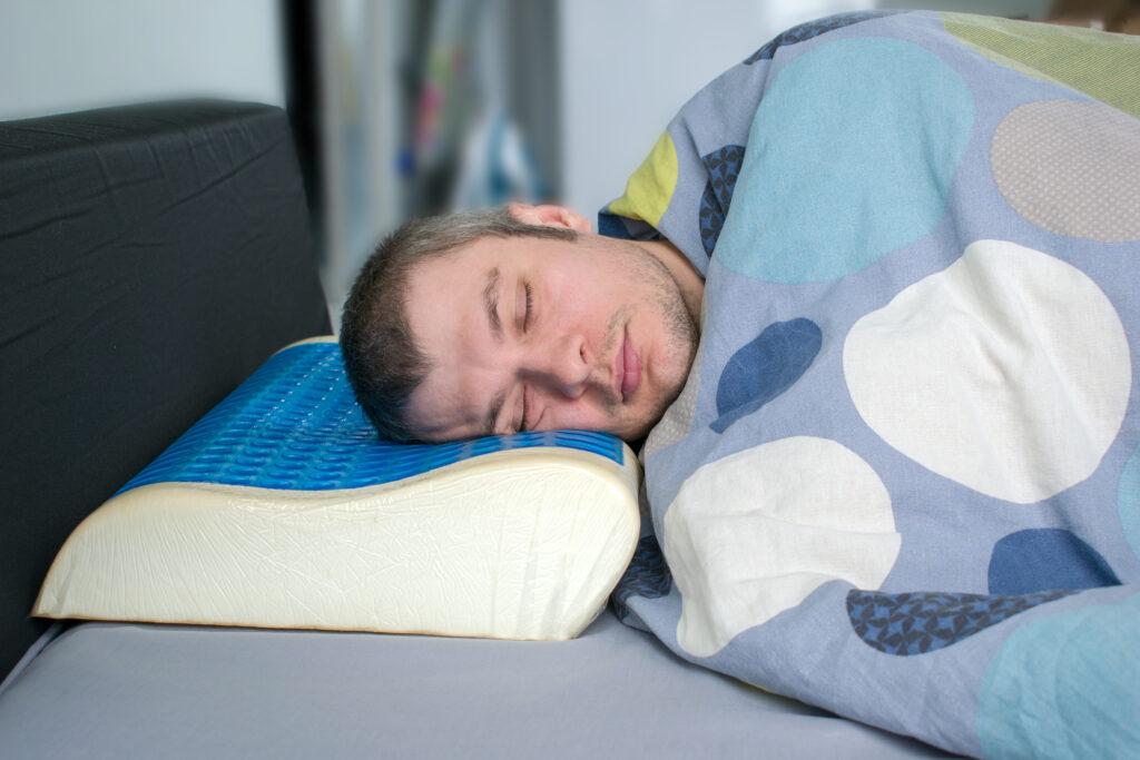 mansleeping on a gel mattress