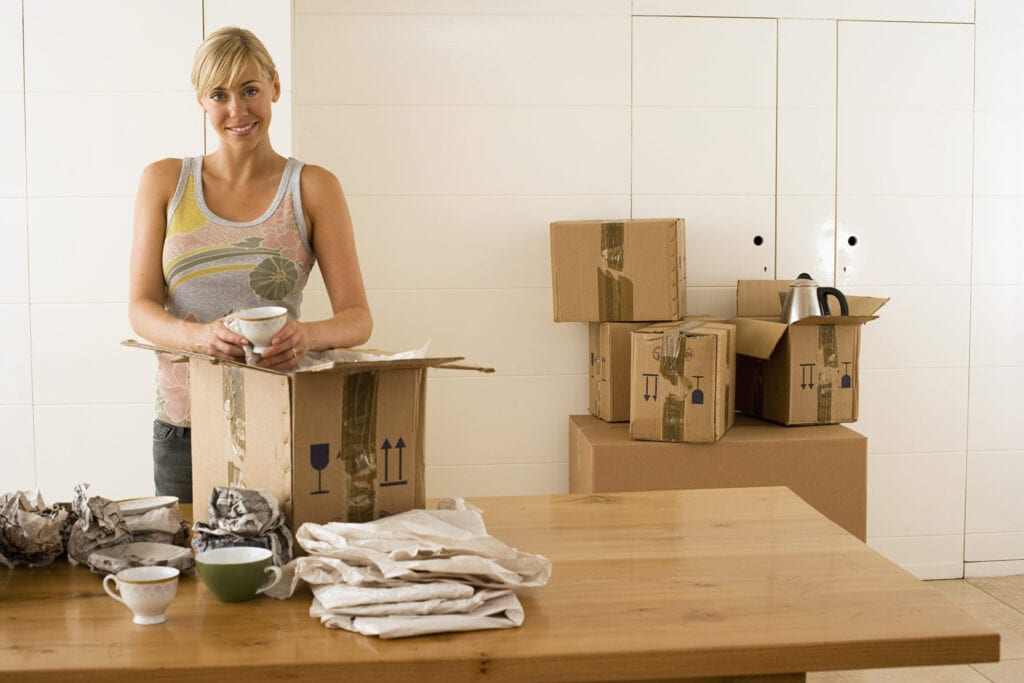 woman packing with newspaper