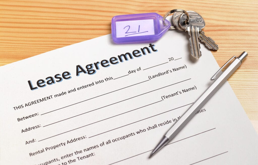 a lease agreement waiting to be signed with house keys