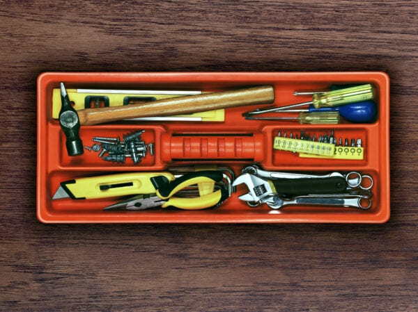 A Diy Tool Tray containing hammers, screwdrivers, pliers, level, spanners and screws