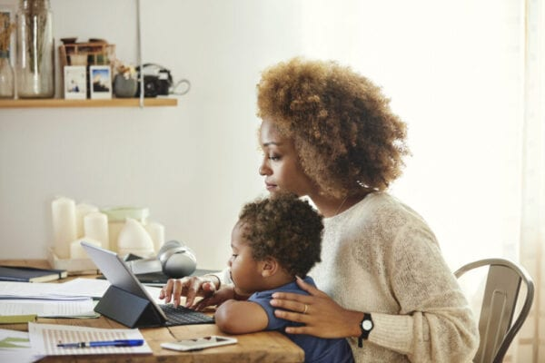 black woman and her son at the computer