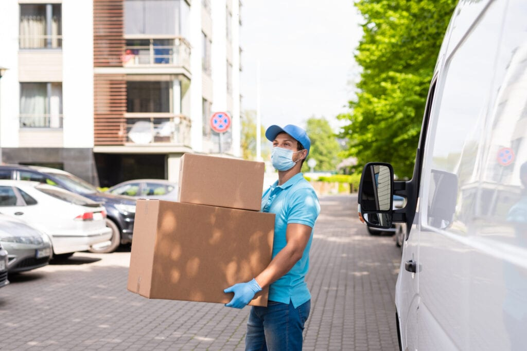 Young man moving while wearing a mask during the coronavirus pandemic