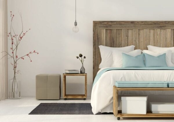 Greige colored bedroom with wood bed