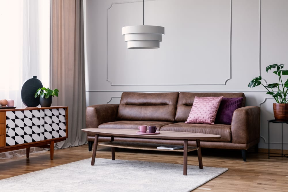 A grey and purple living room styled in mid-century modern decor.
