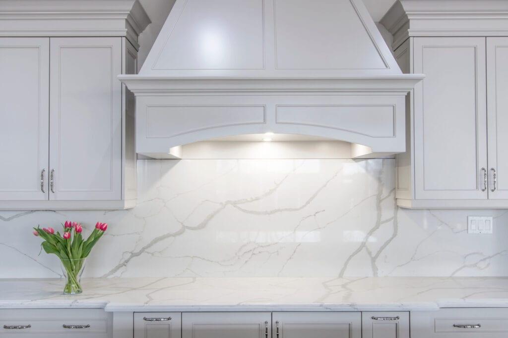 Traditional kitchen with white marble backsplash