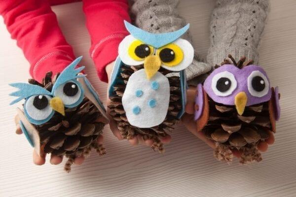Create owl-themed pine cones!