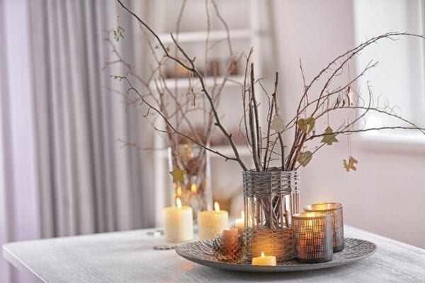 Lighted twigs in a vase