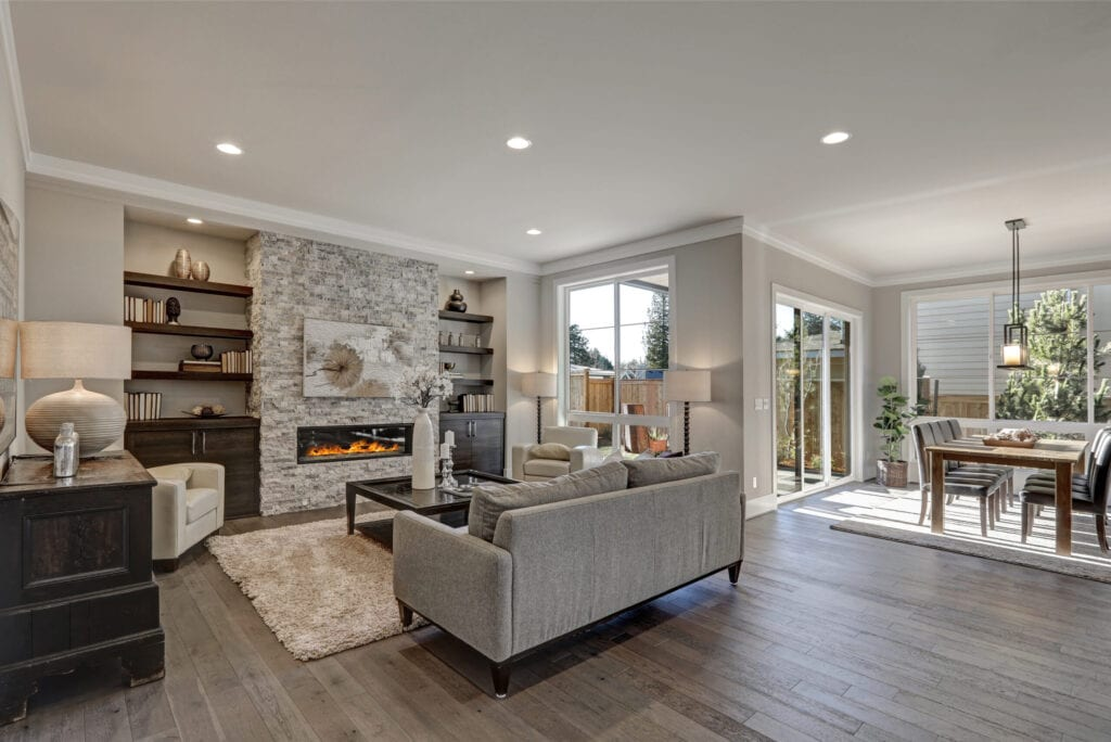 Greige home with open floorplan, view of living room and dining room