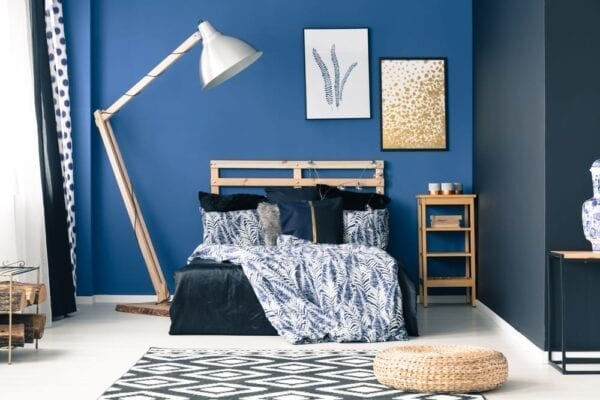 Blue teen bedroom with bold accent wall
