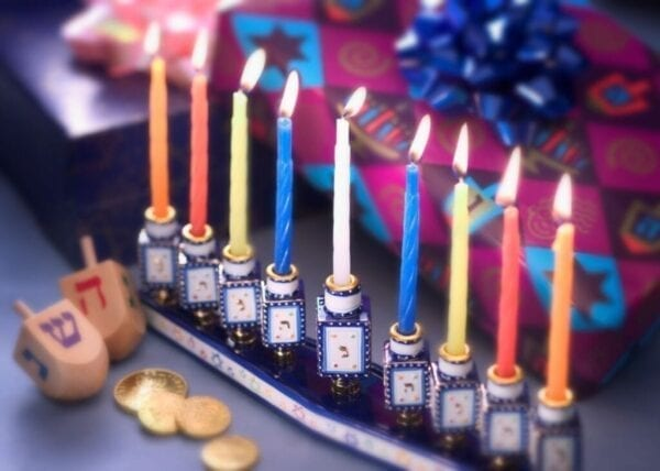Menorah with dreidels and lit candles