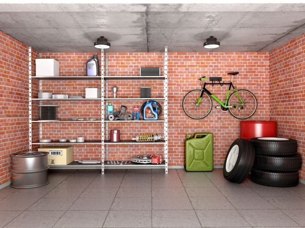 Garage with brick wall well organized with bike rack and storage shelves