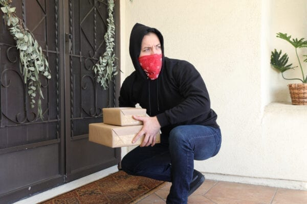 Man steals packages off porch.  Shot in Moreno Valley, California in November of 2020.