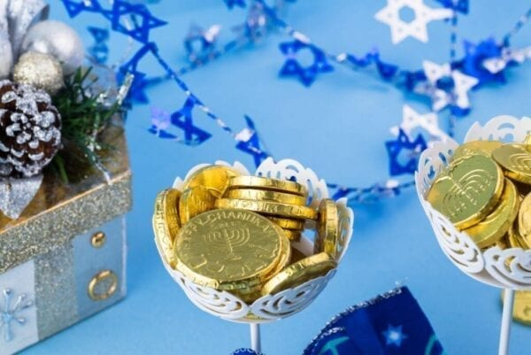 Close up of Hanukkah gelt displayed on decorated tables