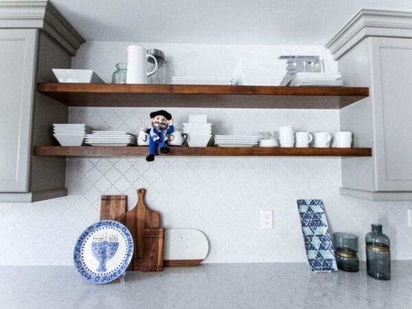 Kitchen decorated with hanukkah plates and other items