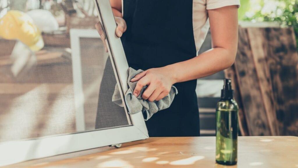 Person repairing window screen