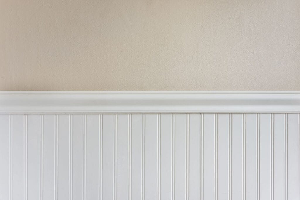 Freshly painted wall with white trim and beige paint