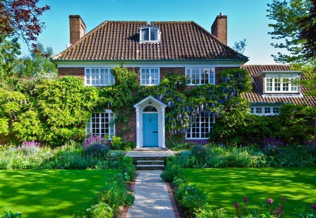 English house with beautiful path in front lawn