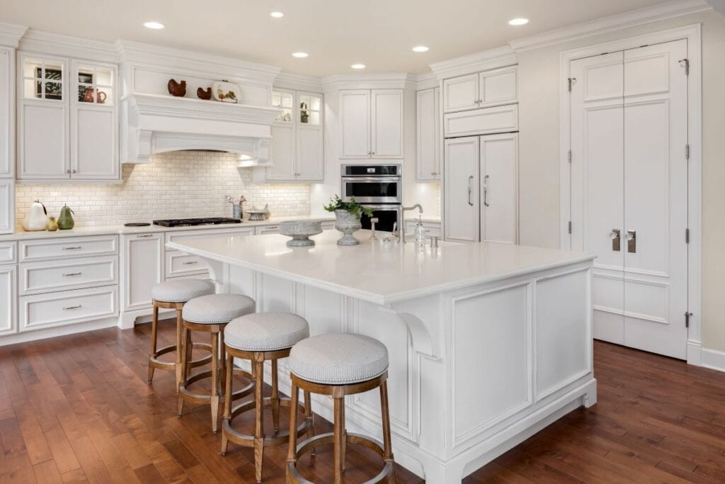 Traditional luxury kitchen with island and barstools