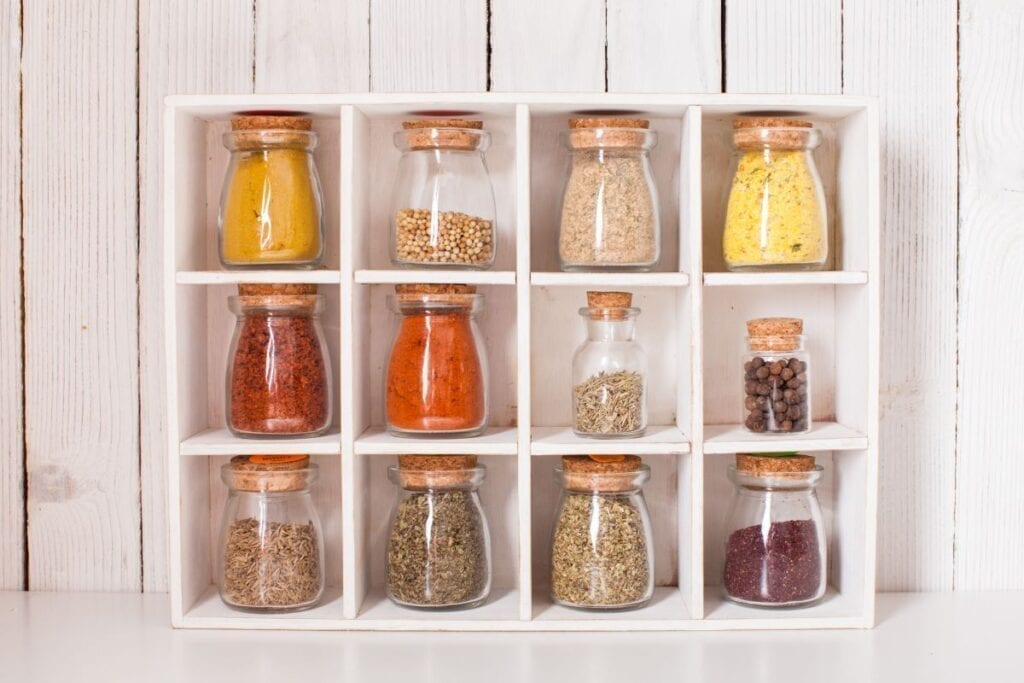 Spices on display in glass jars in kitchen for decor