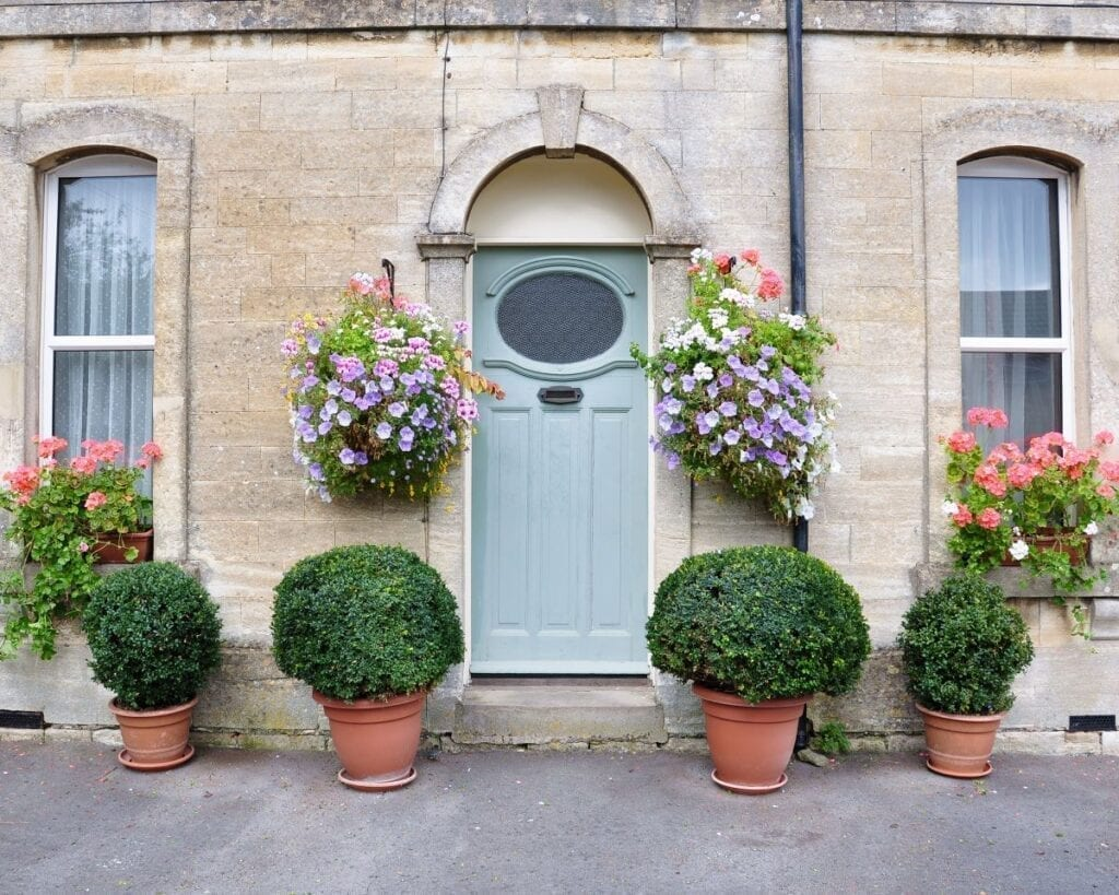 Townhouse landscaping with potted plants