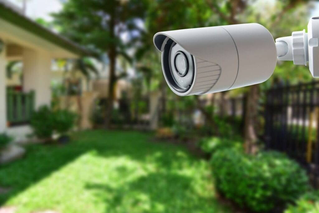 Home security camera facing package drop zone in front yard