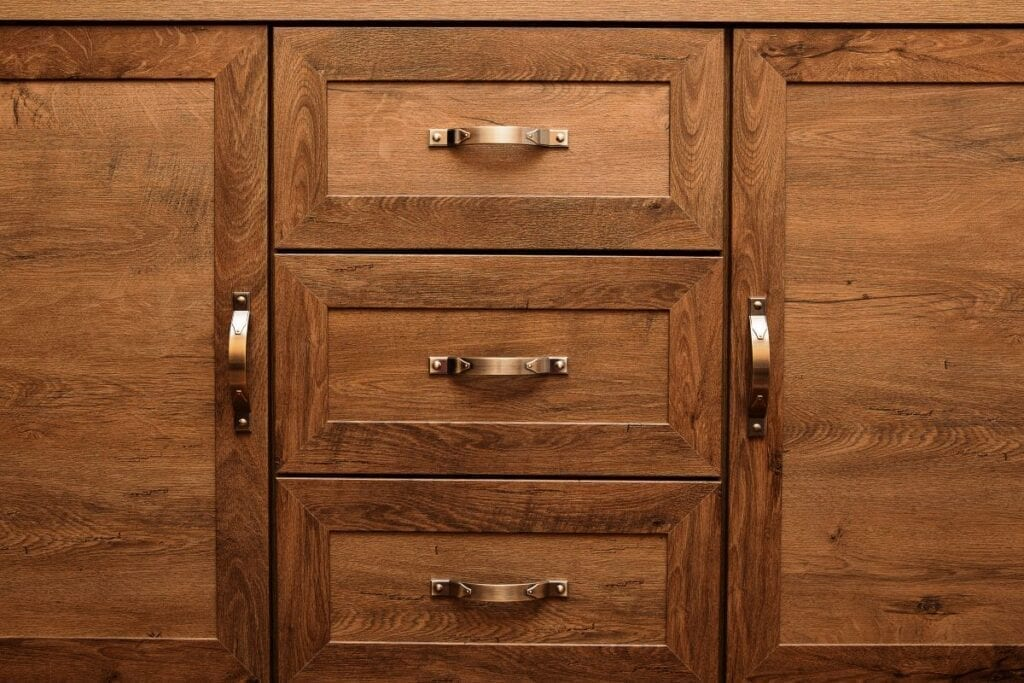 Wood kitchen cabinets with vintage bronze handles