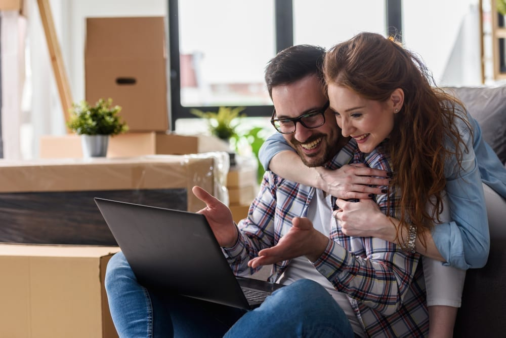 Young couple looks for online bank when they move.