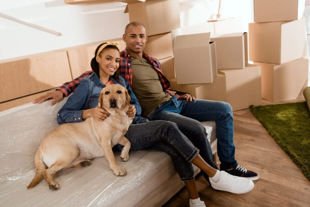 African American couple moving with dog