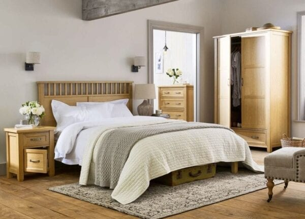 Bedroom furniture arranged to maximize space
