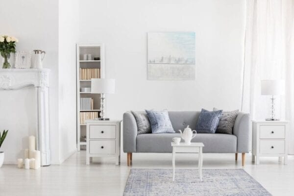 Well-decorated living room with fresh coat of white paint