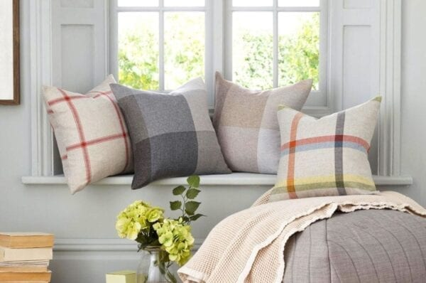 Decorative throw pillows add a finishing touch to the windowsill