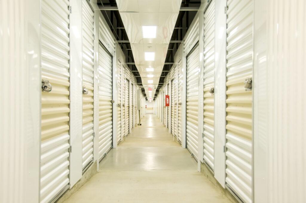 """Self Storage hall with lights, locks, door and concrete floor. Diminishing perspective"""