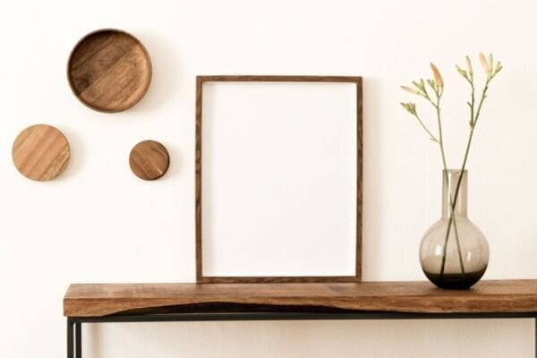 Modern home decorating with wood accents on a shelf