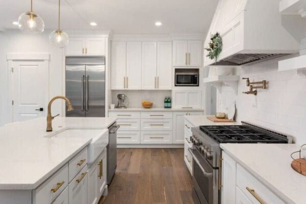 Kitchen is newly decorated with white-painted ktichen cabinets
